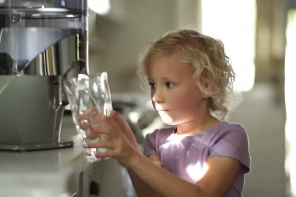 child drinking filter water