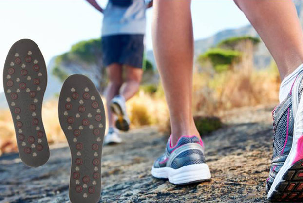 A close up of feet running and wearing sports trainers. Kenko MStride insoles are on the left of the image.