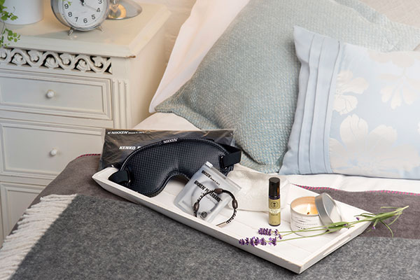 Gift of sleep light products arranged on a bed