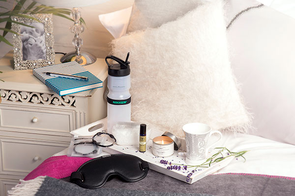 Gift of sleep deep products arranged on a bed