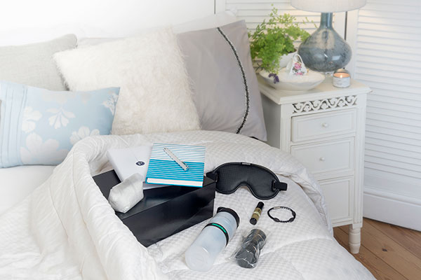 Gift of sleep divine products arranged on a bed