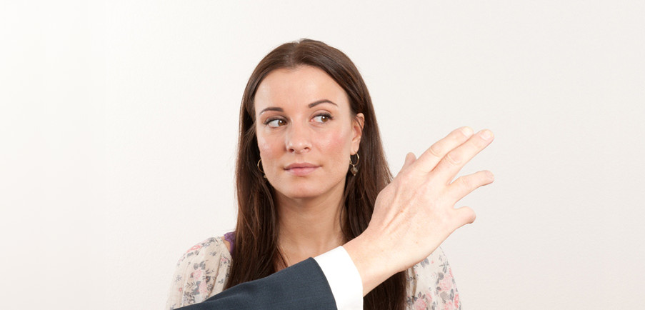 Demonstrating the wave of the hand to allow the client's eyes to follow
